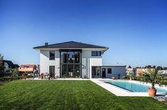 Moderne Stadtvilla mit Zeltdach - Tauber Architekten und Ingenieure