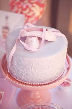 take away the ballerina slippers and tip with cupcake draped with pearls and butterflies
