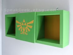 Zelda –Triforce Hylian Crest - Shadow Box Shelf - Home Decor - Cubbie Shelf - Hand Made - Hand Painted – Hyrule Green and Gold by SpeakGeek on Etsy https://www.etsy.com/listing/228086476/zelda-triforce-hylian-crest-shadow-box