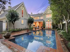 Pool and Patio - This magical view looking back at the home over the pool shows that the home is as ...