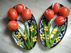 Stuffed cherry tomatoes, chives, and corn kernels.....whimsical presentation.
