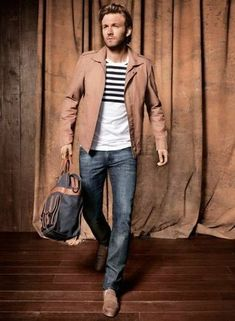 Men's White and Black Horizontal Striped Crew-neck T-shirt, Blue Jeans, Brown Driving Shoes, Navy Backpack