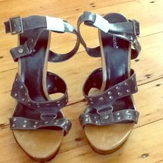 Leather, Studded, Ankle-wrap Sandals NWT These NWT, Ankle-wrap, platform sandals are super hot, with their leather, studded, straps, still wrapped and protected as they came! These sandals will make any outfit look extra hot and edgy! Got to have them!! Shoedazzle Shoes Sandals