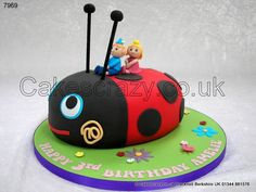 The enchanted little kingdom....  Gaston the ladybug childrens cake taking his best friends Ben and Holly for a ride on his back. Hand modelled characters from icing.  The perfect cake for young followers of the show