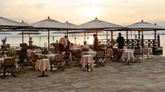Sunset cocktails are a glorious island indulgence at the St. Regis Venice San Clemente Palace.