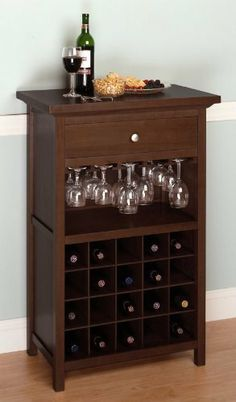 Wine Cabinet with Drawer and Glass Holder by Furniture. $238.38. Up to 50% savings. Direct from manufacturer. Low shipping rates. Brand new. This beautifully walnut polished wine cabinet can hold up to 20 wine bottles, plenty of wine glasses, and a drawer for accessories. Holds everything you need to serve and store your wine in one piece! Features:    Holds up to 20 bottles   Drawer to store accessories   Slide in wine glass holder   Flat table top to pour your wine  F...