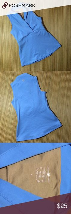 Lululemon blue exercise /yoga top. Size 6 New without tags. Beautiful blue Lululemon yoga top with v neck. Size 6. Fits like xxs. Excellent never worn condition. lululemon athletica Tops Tank Tops