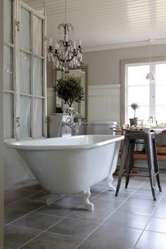Elegant vintage bathroom, clawfoot bathtub, chandelier, antique paned window, beadboard  #white #neutral