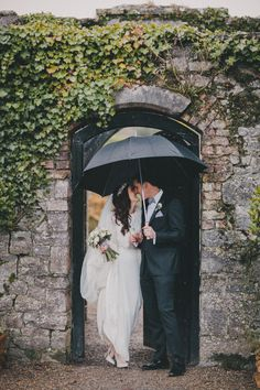 Beautiful Rainy Ireland Wedding Portrait | Winter Dromoland Castle wedding by David Olsthoorn Photography | www.onefabday.com