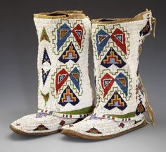 55130: A MATCHED PAIR OF SIOUX WOMAN'S BEADED HIDE LEGG : Lot 55130