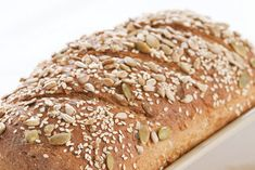 Recipe for Sprouted Grain Bread using whole wheat berries, quinoa, lentils, honey, sunflower seeds, sesame seeds. Directions on how to sprout the grains and prepare the bread dough.
