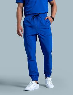Jogger Pant in Royal Blue is a contemporary addition to men's medical scrub outfits. Shop Jaanuu for scrubs, lab coats and other medical apparel. Scrubs Outfit, Scrubs Uniform, Men In Uniform, Jogger Pants, Joggers, Stylish Scrubs, Track Pants Mens, Workwear Trousers, Punk Outfits