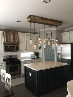 Hi all! Updated pics @ourfauxfarmhouse on IG. COME FOLLOW! Thanks! {holly} Lauritzen Home Projects. Mason Jar Light and Faux Oven Hood (pallet wood)