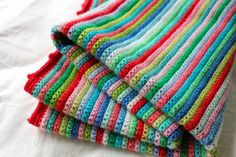 found on little woollie: Skinny Stripe Finish...., just sc. But I'm making mine in rows of 3 and HTR, Sylecraft Special DK in random colours as I go along. Chain 150 for foundation chain