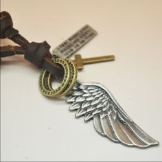 """SPECIAL Angel Wing on Leather Angel Wing hanging in adjustable leather necklace. Quote: """"I feel about you makes my heart lone to be free""""  ~ pendant: angel wing/quote bar/cross/2 eternity rings Jewelry Necklaces"""
