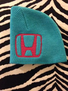 Cotton beanie with embroidered Honda logo. Comes in child and adult sizes. Made to order. Usually ships out in 2-5 business days. PLEASE BE