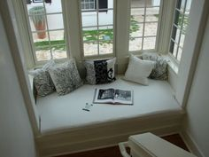 cute window seat area.  no source info. This is a great look for the window nook in the living room.