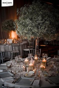 This is what I want!! Tall big bursts of baby's breath surrounded by glowing candles :)