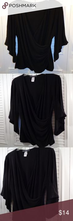 """Coco Bianco:  Stylish Faux Wrap Top  M-L (L) A stylish black top featuring a faux wrap draped sleeve with a slit and ruching. This piece looks great for work or for a night on the town with slim-leg jeans or just about anything and a pair of heels.  Measurement: Underarm seam to other is 20"""" no stretch, length is 23"""" 1/2 no stretch. Condition:  Excellent.  Fabric:  96% Polyester, 4% Spandex Coco Bianco Tops Blouses"""