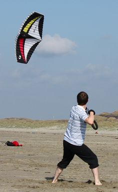 """A picture of traction kite power. This foil is demanding plenty of effort and attention from it's owner. T.P. (my-best-kite.com) """"Kite"""" Cropped from a photo by Lukas Vermeer on Flkr."""