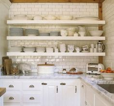 lovely open shelving... so dreamy with the wood trim, subway tile, white cabinets, & all those dishes!
