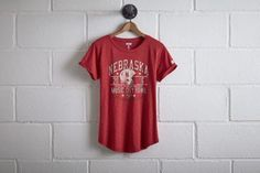 Tailgate Nebraska Music City Bowl T-Shirt by  American Eagle Outfitters   Once known as the Nebraska Bugeaters, the university officially became the Cornhuskers starting in 1900. Shop the Tailgate Nebraska Music City Bowl T-Shirt and check out more at AE.com.