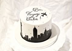 Bon Voyage Cake with White Fondant and Hand Painted Lettering and NYC Skyline silhouette