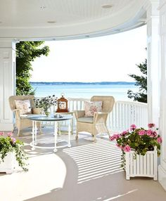 White box planters. Wicker chairs with pillows add a little romance to a seating area overlooking Lake Michigan. - Traditional Home ® / Photo: Werner Straube / Design: Tom Stringer