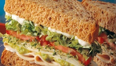 #12 BEACH CLUB®  Fresh baked turkey breast, provolone cheese, avocado spread, sliced cucumber, sprouts, lettuce, tomato, and mayo! (It's the real deal, and it ain't even California.)