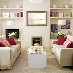 A modern symmetrical living room - love the pop of red!