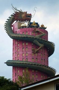 (Sam Pran/ Thailand) The Wat Sanpran Dragon Temple is a 16-storey red tower with a statue of a dragon wound around it. The temple complex consists of smaller temples and many statues inspired by dragons and the chinese zodiac.