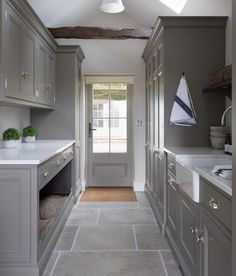 This door to this utility room opens onto the garden behind, so with pets and children hardwearing natural limestone flooring is essential. Boot Room Utility, Utility Room Storage, Dog Storage, Boot Room Storage, Utility Sink, Pantry Storage, Mudroom Laundry Room, Laundry Room Design, Küchen Design