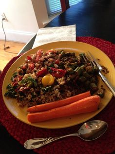 Black eyed peas, brown rice with sauteed kale, baked okra, and baked carrots in olive oil.  Fresh yellow and red cherry tomatoes garnish.