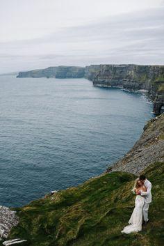 Wedding portrait on the Cliffs of Moher Ireland. Bride & Groom.