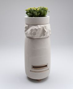 A cylindrical concrete beehive for urban beekeepers to use on the roofs of city buildings
