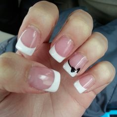 French manicure with a cute black bow on the ring finger