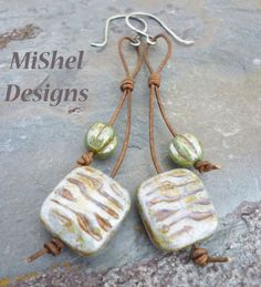 Ceramic beads on genue leather with handcrafted, custom ear wires from Shel's Jewelry Supplies over on Etsy.