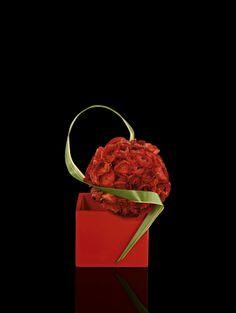 Redranuncolos and formium on red laquer cube #Armani/Fiori