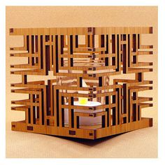 This intricate, laser-cut votive holder is adapted from the textile block design of the Millard House in Pasadena, California, designed by Frank Lloyd Wright.