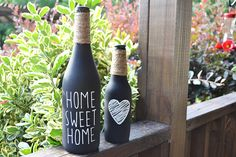 This set of bottles - one wine bottle and one beer bottle - are painted in chalkboard paint. They also feature twine wrapped at the tops to