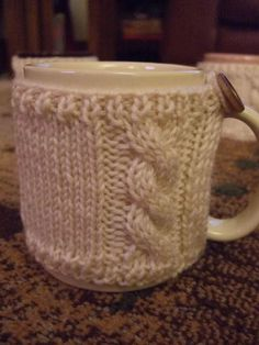 Great gift idea for coffee lovers--get plain mug, write appropriate quote around edge with sharpie, bake mug then wrap knitted cosy around it. (if it's for Neil, cricket quote then the cosy cable knitted with England colour stripes!)