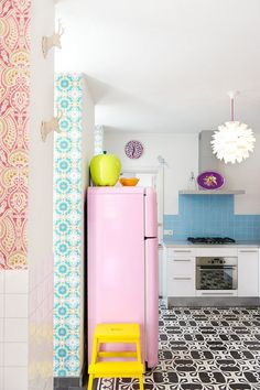 Colourful kitchen. Pink fridge.