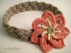 "There's a link to free pattern for the flower used in this ""Braided Headband with 7-petal Flower""!"