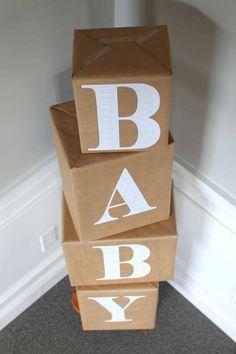 Decoração de chá de bebê com caixas encapadas DIY