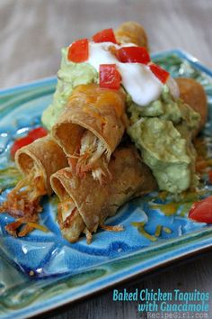 Baked Chicken Taquitos with Guacamole. These were good and pretty easy but next time I would use small flour tortillas instead of the corn ones and also put some black beans in the taquitos. Taquitos Recipe, Chicken Taquitos, Chicken Tacos, Homemade Taquitos, Baked Taquitos, Mexican Dishes, Mexican Food Recipes, Yummy Eats, Yummy Food