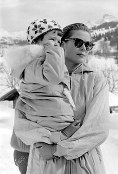 Grace Kelly, baby and sunglasses