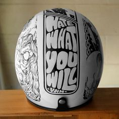 Another stunning job of helmet paint designs by The VNM. The design on the helmet is really nice the line drawing on one side must have.