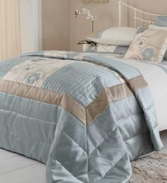 Quilted throw.  http://www.worldstores.co.uk/p/Catherine_Lansfield_Alicia_Duck_Egg_Bedding_Set.htm