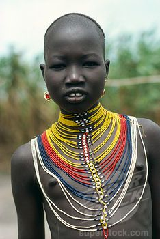 Sudan, Body Decoration, 'Young Dinka Girl Wearing Multi Stranded Necklace Made From Tiny Yellow, Red, Blue And White Coloured Beads' Stock Photo Tribal Women, Tribal People, African Girl, African Women, African Fashion, African Beads, African Jewelry, Costume Ethnique, Xingu