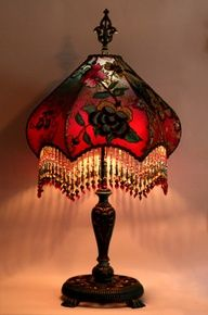 Detailed, hand-painted antique lamp base holds a hand-dyed Fuschia Peony & Butterfly silk lampshade. The shade is ombre-dyed from deep teal to fuschia and covered with brilliantly colored antique Asian flowering vine appliqués The shade is covered in a rich gold and black net and then overlaid with the floral motifs.    The colors on this lamp are intense and beautiful while on or off and lights up beautifully. The shade has hand beaded fringe in matching tones.